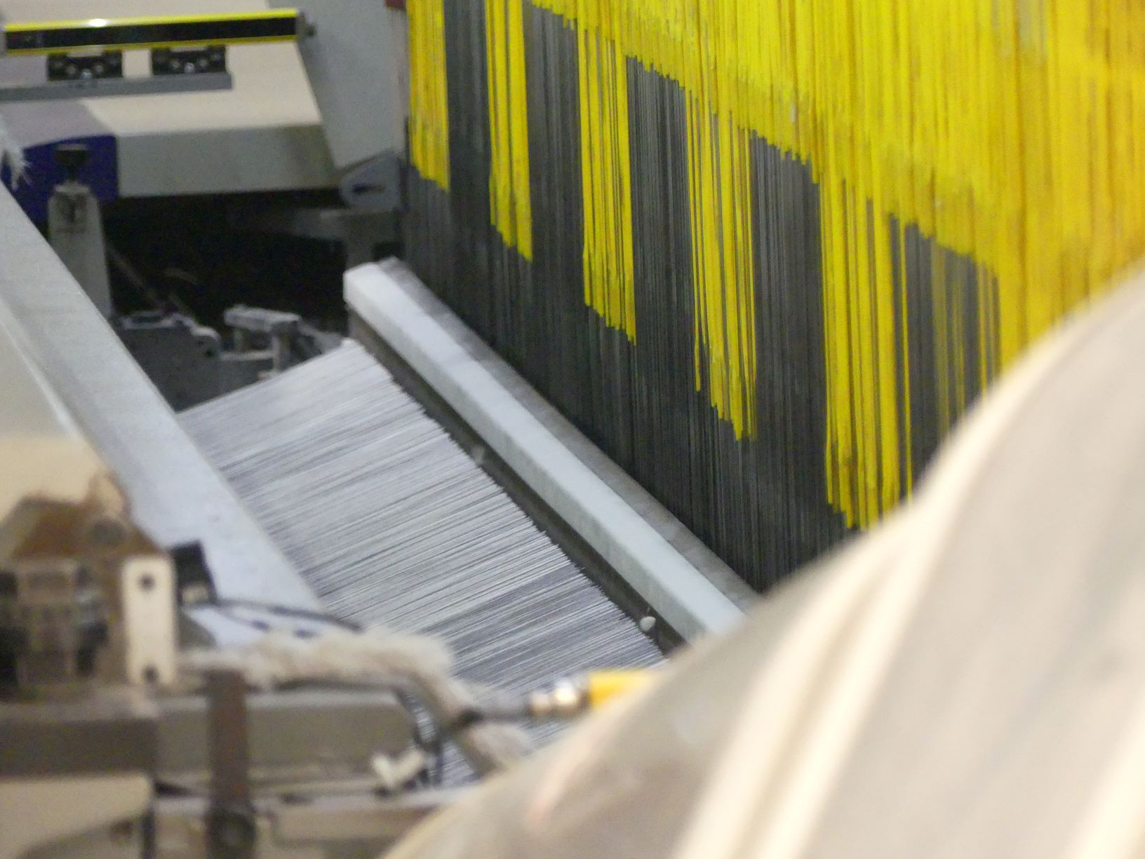 Rug being made on a powerloom