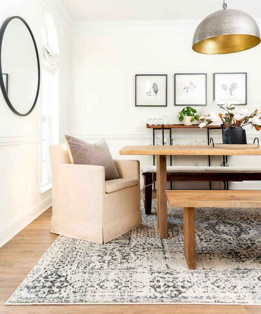 Beige coastal style rug in dining room
