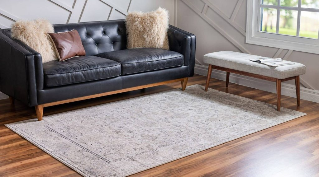modern style rug in living room with leather couch