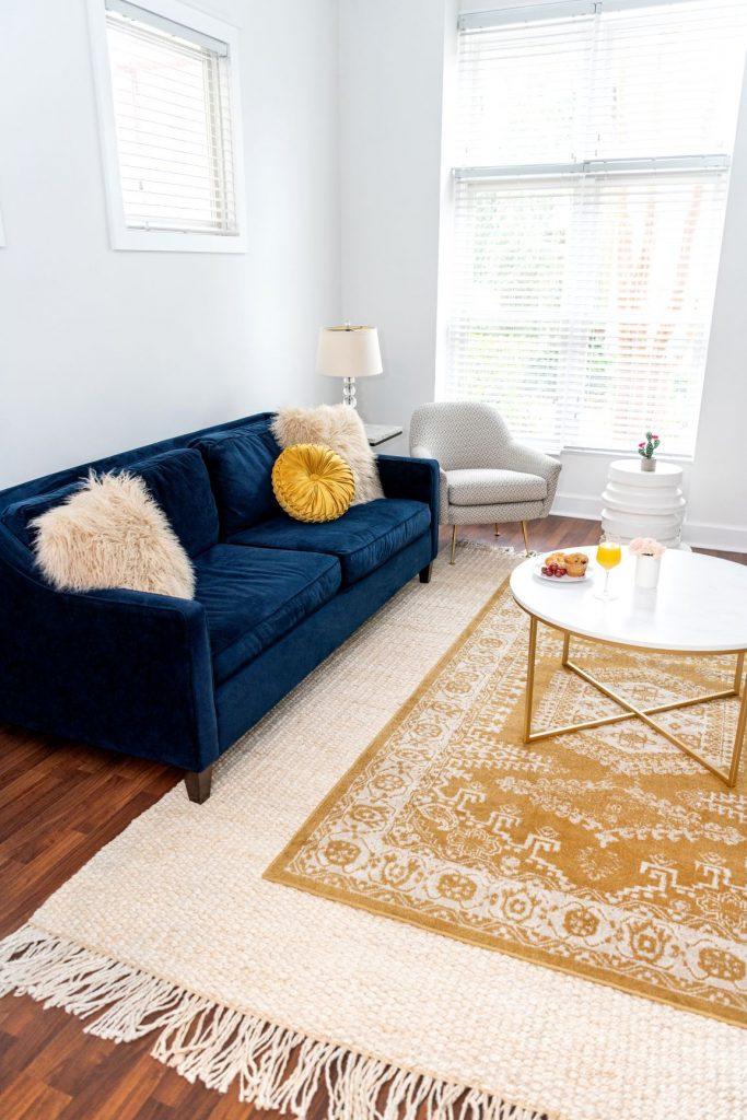 layering yellow rug on jute rug