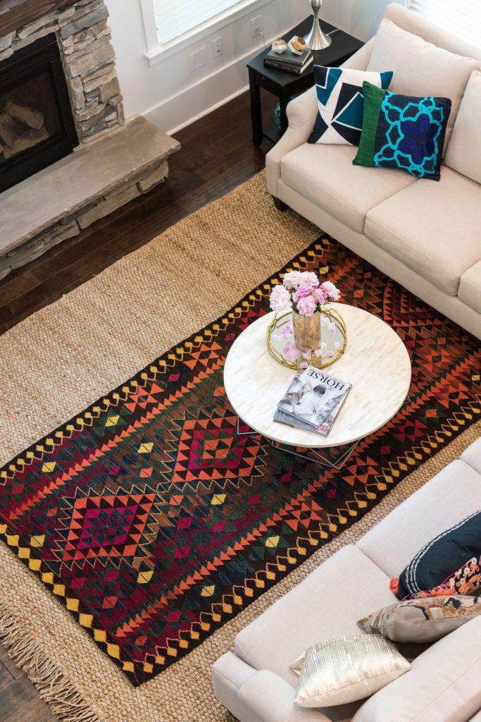 layering tribal rug on jute rug
